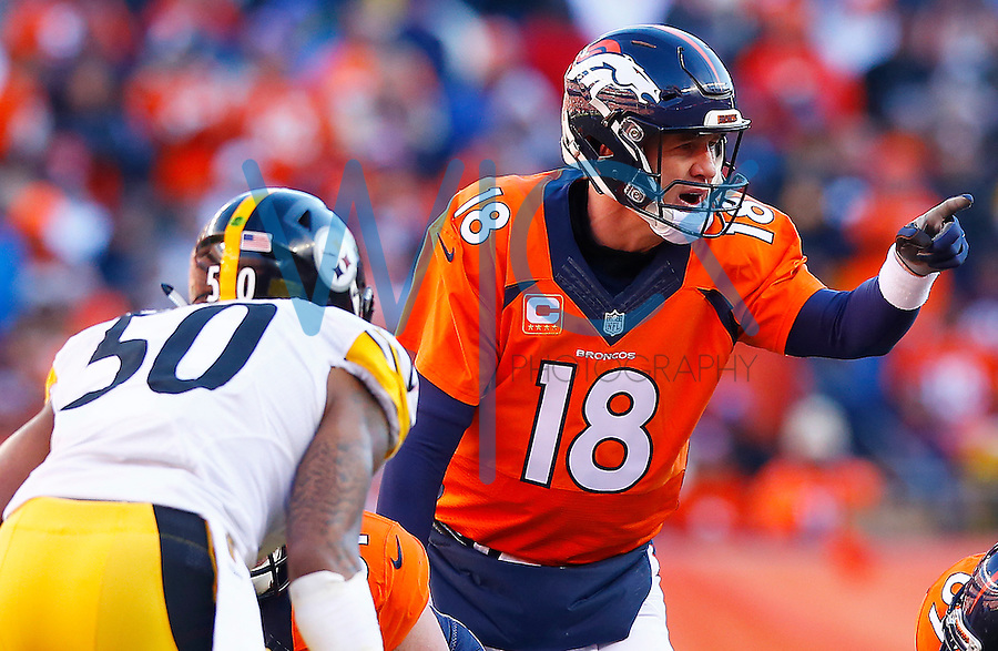 Peyton Manning #18 of the Denver Broncos stands behind center against the Pittsburgh Steelers in the first half during the AFC Divisional Round Playoff game at Sports Authority Field at Mile High on January 17, 2016 in Denver, Colorado. (Photo by Jared Wickerham/DKPittsburghSports)