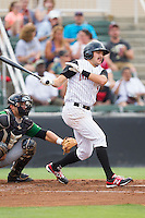 Christian Stringer (8) of the Kannapolis Intimidators follows through on his swing against the Savannah Sand Gnats at CMC-Northeast Stadium on June 9, 2014 in Kannapolis, North Carolina.  The Intimidators defeated the Sand Gnats 4-2.  (Brian Westerholt/Four Seam Images)