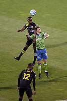COLUMBUS, OH - DECEMBER 12: Harrison Afful #25 of Columbus Crew battles for the ball against Nicolas Lodeiro #10 of Seattle Sounders FC during a game between Seattle Sounders FC and Columbus Crew at MAPFRE Stadium on December 12, 2020 in Columbus, Ohio.