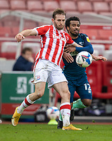 20th March 2021; Bet365 Stadium, Stoke, Staffordshire, England; English Football League Championship Football, Stoke City versus Derby County; Rhys Norrington-Davies of Stoke City holds off the pressure from Nathan Byrne of Derby County
