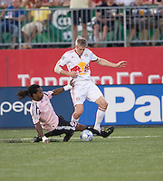 24 June2009: New York Red Bulls forward John Wolyniec #15 and Toronto FC defender Adrian Serioux #15 in action at BMO Field in Toronto, in a game between the New York Red Bulls and Toronto FC. Toronto FC won 2-0..