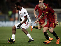 Calcio, Serie A: AS Roma - AC Milan, Roma, stadio Olimpico, 25 febbraio, 2018.<br /> Milan's Frank Kessie (l) in action with Roma's Radja Nainggolan (r) during the Italian Serie A football match between AS Roma and AC Milan at Rome's Olympic stadium, February 28, 2018.<br /> UPDATE IMAGES PRESS/Isabella Bonotto
