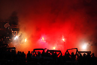 Calcio, quarti di finale di Coppa Italia: Roma vs Juventus. Roma, stadio Olimpico, 21 gennaio 2014.<br /> AS Roma forward fans light flares prior to the start of the Italian Cup round of eight final football match between AS Roma and Juventus, at Rome's Olympic stadium, 21 January 2014.<br /> UPDATE IMAGES PRESS/Riccardo De Luca