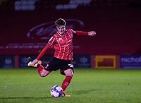Lincoln City's Robbie Gotts scores his penalty<br /> <br /> Photographer Andrew Vaughan/CameraSport<br /> <br /> EFL Papa John's Trophy - Northern Section - Group E - Lincoln City v Manchester City U21 - Tuesday 17th November 2020 - LNER Stadium - Lincoln<br />  <br /> World Copyright © 2020 CameraSport. All rights reserved. 43 Linden Ave. Countesthorpe. Leicester. England. LE8 5PG - Tel: +44 (0) 116 277 4147 - admin@camerasport.com - www.camerasport.com