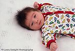 baby boy newborn: 7 weeks old closeup, on back, reflex: tonic neck (fencing)