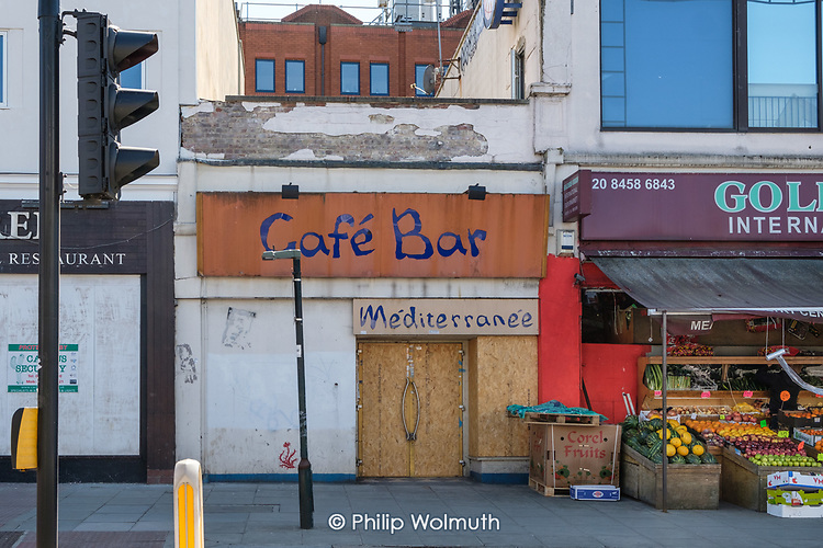 Covid-19 pandemic. Closed and boarded up Cafe Bar, Golders Green, London.