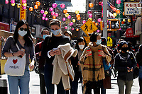 NEW YORK - NEW YORK - MARCH 21: People walk around Chinatown on March 21, 2021 in New York. In the last two months, more than 500 attacks on Asians have been reported in United States. (Photo by John Smith/VIEWpress)