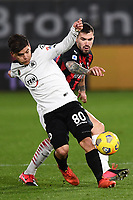 Kevin Agudelo of Spezia Calcio and Alessio Romagnoli of AC Milan compete for the ball during the Serie A football match between Spezia Calcio and AC Milan at Spezia stadium in Spezia (Italy), February 13th, 2021. Photo Image Sport / Insidefoto