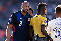 DENVER, CO - JUNE 3: John Brooks #6 of the United States has a few words for Alberth Elis during a game between Honduras and USMNT at EMPOWER FIELD AT MILE HIGH on June 3, 2021 in Denver, Colorado.