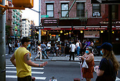 New York New York<br /> June 6, 2020<br /> <br /> After several nights of looting, nearly all ground level windows in Soho are covered with plywood. Most of the shops had been looted others are boarded for protection. <br /> <br /> At curfew hours - 8pm till 5am police cordon of certain streets and only allow residence with an ID to pass.<br /> <br /> On other streets people came out to congregate for the first time in months as both curfew and coronavirus quarantine would be lifted within a day.