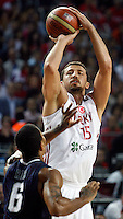 Hidayet TURKOGLU (Turkey)  shoots over Derrick ROSE (USA) during the Final World championship basketball match against USA in Istanbul, Turkey-USA, Turkey on Sunday, Sep. 12, 2010. (Novak Djurovic/Starsportphoto.com) .