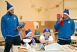 St Johnstone players took some festive cheer to Fairview School in Perth gving out selection boxes and gifts to the pupils…Zander Clark and David Wotherspoon having fun with secondary school pupils Noah (left) and Aaron during a cookery lesson <br />