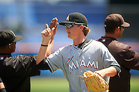 GCL Marlins pitcher Braxton Garrett (44) fist bumps teammates after a game against the GCL Mets on August 12, 2016 at St. Lucie Sports Complex in St. Lucie, Florida.  GCL Marlins defeated GCL Mets 8-1.  (Mike Janes/Four Seam Images)