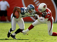 Nov. 6, 2005; Tempe, AZ, USA; Wide receiver (84) Bobby Engram of the Seattle Seahawks is tackled by Arizona Cardinals safety (34) Robert Griffith at Sun Devil Stadium. Mandatory Credit: Mark J. Rebilas