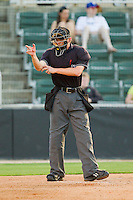 Home plate umpire Clayton Hamm makes a strike call during the South Atlantic League game between the Savannah Sand Gnats and the Kannapolis Intimidators at CMC-Northeast Stadium on May 30, 2013 in Kannapolis, North Carolina. The Intimidators defeated the San Gnats 5-4 in 11 innings..   (Brian Westerholt/Four Seam Images)