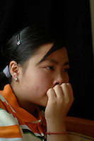 "Fifteen year-old Lou Li cries as she recounts the eight months that she spent forcibly ""married"" to a farmer in Yunnan, West China. Lou Li was tricked away from her home and sold to the farmer for 6,500 RMB in September 2006 and escaped in April 2007.  Girls in China are increasingly targeted and stolen as there is a shortage of wives as the gender imbalance widens with 120 boys for every 100 girls..PHOTO BY SINOPIX"