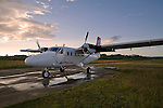 Air Panama plane sitting on the runway in Carti during sunrise, San Blas Islands, Kuna Yala, Panama