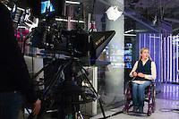 """RUSSLAND, 11.2012. Moskau.  Oppositioneller Fernsehsender Doschd (""""optimistischer Kanal""""), gegruendet von Natalja Sindejewa und Alexander Winokurow. Die Studios befinden sich in der ehemaligen Schokoladenfabrik """"Roter Oktober"""". Unter der Leitung von Sindejewa wird das Studioleben von jungen Frauen gepraegt. – Behinderte Moderatorin.   Oppositional TV-station Dozhd (""""optimistic channel""""), founded by Natalya Sindeyeva and Aleksandr Vinokurov. The studios are located in the famous former chocolate factory """"Red October"""". Led by Sindeyeva young women dominate studio life. – Handicapped programme leader. © Martin Fejer/EST&OST"""