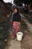 Women from villages on the outskirts of Kanpur collect water from wells that have been sunk deep into the ground. It is feared that the severe pollution has penetrated the groundwater, allowing many harm toxins to enter the water and food chain.