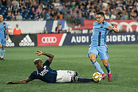 FOXBOROUGH, MA - SEPTEMBER 29: Luis Caicedo #27 of New England Revolution slide tackles Tony Rocha #15 of New York City FC during a game between New York City FC and New England Revolution at Gillettes Stadium on September 29, 2019 in Foxborough, Massachusetts.