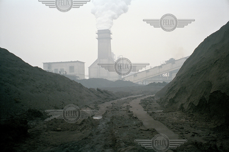 Industrial emissions from a coal coking and tar refinery plant in Linfen, one of the most polluted cities in China. Supplying a large part of the nation's energy, Shanxi is considered to be the centre of China's expanding coal industry. The huge demand for coal has led to the development of hundreds of often illegal and unregulated coal mines, excessive air pollution and many other environmental problems.