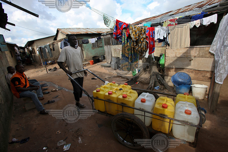 A man selling drinking water to houses in the Gbagi area of Abuja.