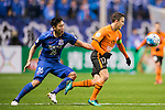 Matt McKay (r) of Brisbane Roar battles for the ball with Qin Sheng of Shanghai Shenhua FC during their AFC Champions League 2017 Playoff Stage match between Shanghai Shenhua FC (CHN) and Brisbane Roar (AUS) at the Hongkou Stadium, on 08 February 2017 in Shanghai, China. Photo by Marcio Rodrigo Machado / Power Sport Images