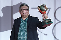 """Director Erik Matti acknowledges receiving, on behalf of actor John Arcilla, the Coppa Volpi for Best Actor in """"On the Job: The Missing 8"""" during the Winners Red Carpet as part of the 78th Venice International Film Festival in Venice, Italy on September 11, 2021. <br /> CAP/MPI/IS/PAC<br /> ©PAP/IS/MPI/Capital Pictures"""