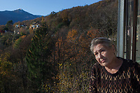 Switzerland. Canton Ticino. Sala. Elsy (Elsa) Hofer Ferrari Ramuz is 86 years old. She stands on the balcony of her home. Elsy Hofer Ferrari Ramuz is the niece of Charles-Ferdinand Ramuz (September 24, 1878 – May 23, 1947) who was a French-speaking Swiss writer. 14.11.2017 © 2017 Didier Ruef