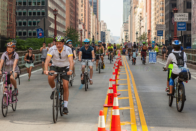 People enjoy a traffic-free Park Avenue as part of New York City's Summer Streets program.
