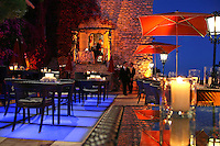 Evening dining on the terrace of hotel restaurant La Chevre D'Or, Eze village, Eze, France, 12 July 2007