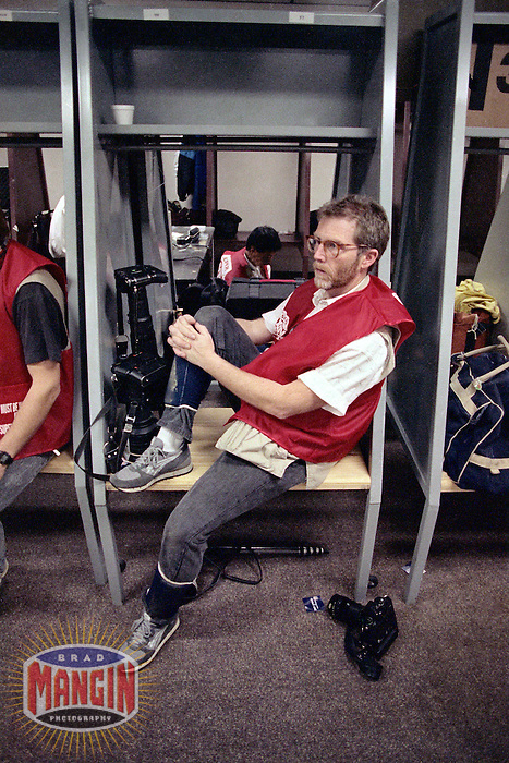 NEW ORLEANS, LA - Photographer Jon McNally relaxes in the locker room before Super Bowl XXIV between the Denver Broncos and San Francisco 49ers at the Louisiana Superdome in New Orleans, Louisiana on January 28, 1990. Photo by Brad Mangin.