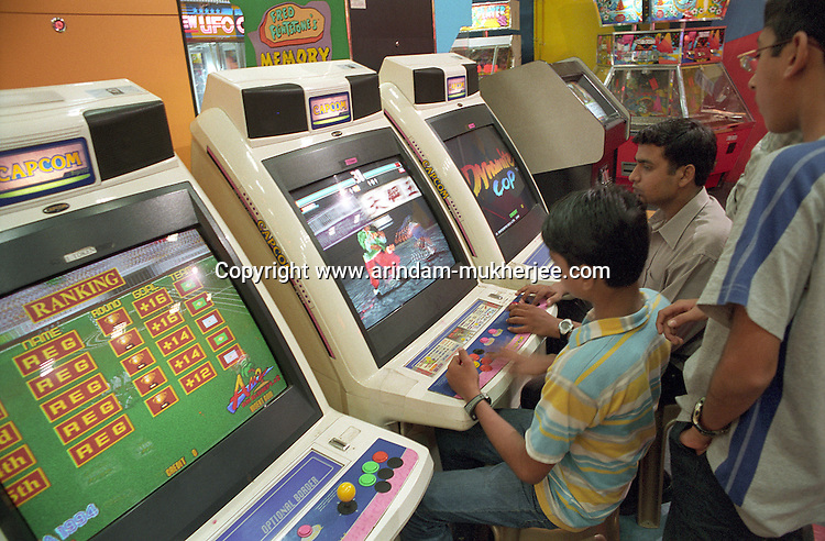 Young boys playing computer games in a parlour inside a shopping center. Calcutta, India . Arindam Mukherjee