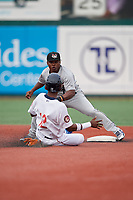 Tri-City ValleyCats second baseman Luis Santana (7) looks to tag Ranfy Adon (12) sliding in during a NY-Penn League game against the Brooklyn Cyclones on August 17, 2019 at MCU Park in Brooklyn, New York.  Brooklyn defeated Tri-City 2-1.  (Mike Janes/Four Seam Images)