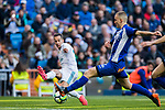Lucas Vazquez (L) of Real Madrid battles for the ball with Rodrigo Ely of Deportivo Alaves during the La Liga 2017-18 match between Real Madrid and Deportivo Alaves at Santiago Bernabeu Stadium on February 24 2018 in Madrid, Spain. Photo by Diego Souto / Power Sport Images