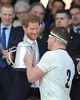 Prince Harry speaks to England captain Dylan Hartley as he is presented with the Calcutta Cup during the RBS 6 Nations match between England and Scotland at Twickenham Stadium on Saturday 11th March 2017 (Photo by Rob Munro/Stewart Communications)