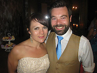 BNPS.co.uk (01202 558833).Pic: BNPS..Chloe Mayo and husband Michael on their wedding day..Artist Chloe Mayo painted a picture of her perfect husband before setting eyes on an identical real-life version of the man she has married...Chloe, 31, created the prophetic image of a herself holding hands with a male partner who had a dark beard...She forgot about the hastily-painted picture and weeks later joined an online dating website...Chloe spent two months messaging Michael Goeman, 30, through the singles site before meeting him face to face...After dating for six weeks Chloe thought Michael's face looked familiar and then remembered her painting and realised he was the spitting image of the man she painted...Because the oil painting was so uncannily similar to Michael, she hid the canvas under her bed in fear he thought she may have been stalking him...When she finally revealed the image to him a week later he was stunned at the resemblance, but to her relief he was not put off and actually proposed 18-months later...The couple were married at a ceremony near their home in May 2012 and have proudly hung the painting up in their lounge in Worcester Park, near Croydon in Surrey..