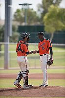 San Francisco Giants relief pitcher Gregory Santos (76) talks to catcher Ricardo Genoves (15) during an Instructional League game against the Kansas City Royals at the Giants Training Complex on October 17, 2017 in Scottsdale, Arizona. (Zachary Lucy/Four Seam Images)