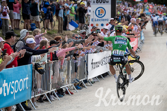 Green Jersey Peter Sagan (SVK/Bora-Hansgrohe) entertaining the crowd with his signature wheelie up the gravel section in the final stretch to the finish line up La Planche des Belles Filles<br /> <br /> Stage 6: Mulhouse to La Planche des Belles Filles (157km)<br /> 106th Tour de France 2019 (2.UWT)<br /> <br /> ©kramon