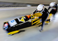 14 December 2006: Sabina Hafner, team pilot from Switzerland, pushes her sled at the start of a training run in preparation for the World Cup Bobsleigh Competition at the Olympic Sports Complex on Mount Van Hoevenburg  in Lake Placid, New York, USA.&#xA;&#xA;Mandatory Photo credit: Ed Wolfstein Photo<br />