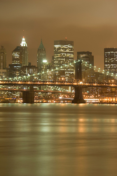 Lower Manhattan Cityscape on an Overcast Night-East River, Manhattan Bridge, Brooklyn Bridge and Lower Manhattan Skyline....New York City, New York State, USA
