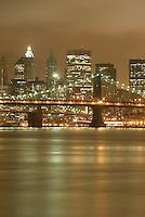 Lower Manhattan Cityscape on an Overcast Night-East River, Manhattan Bridge, Brooklyn Bridge and Lower Manhattan Skyline....New York City, New York State, USA
