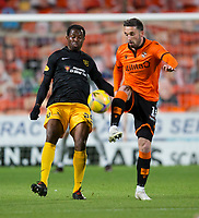 2nd October 2020; Tannadice Park, Dundee, Scotland; Scottish Premiership Football, Dundee United versus Livingston; Nicky Clark of Dundee United challenges for the ball with Efe Ambrose of Livingston