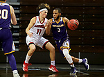 SIOUX FALLS, SD - MARCH 6: Mason Archambault #11 of the South Dakota Coyotes applies pressure to Justin Brookens #3 of the Western Illinois Leathernecks during the Summit League Basketball Tournament at the Sanford Pentagon in Sioux Falls, SD. (Photo by Dave Eggen/Inertia)