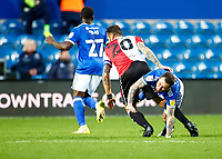 31st October 2020; The Kiyan Prince Foundation Stadium, London, England; English Football League Championship Football, Queen Park Rangers versus Cardiff City; Geoff Cameron of QPR and substitute Lee Tomlin of Cardiff City challenge for the ball