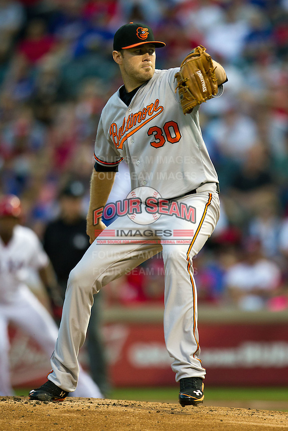 Baltimore Orioles pitcher Chris Tillman #30 winds up during the Major League Baseball game against the Texas Rangers on August 21st, 2012 at the Rangers Ballpark in Arlington, Texas. The Orioles defeated the Rangers 5-3. (Andrew Woolley/Four Seam Images).
