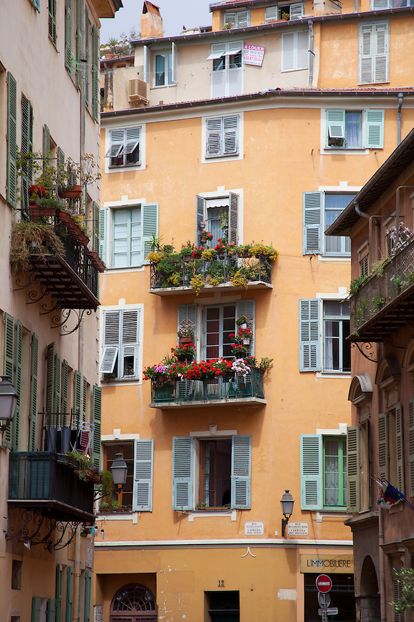 Old house in Nice, France. Flowers on the balcony