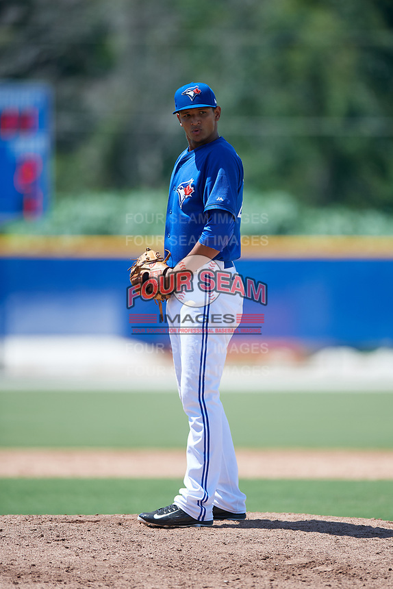 GCL Blue Jays relief pitcher Danilo Manzueta (28) gets ready to deliver a pitch during a game against the GCL Pirates on July 20, 2017 at Bobby Mattick Training Center at Englebert Complex in Dunedin, Florida.  GCL Pirates defeated the GCL Blue Jays 11-6 in eleven innings.  (Mike Janes/Four Seam Images)