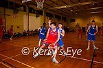 Billy Wiseman Cougars shields the ball from Ryan Murphy Blue Demons during their National league game in Killarney on Saturday night