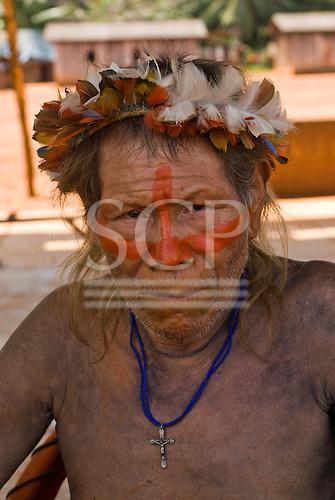 Pará State, Brazil. Aldeia A-Ukre (Kayapó). Kupatu Kayapó with feather headdress.